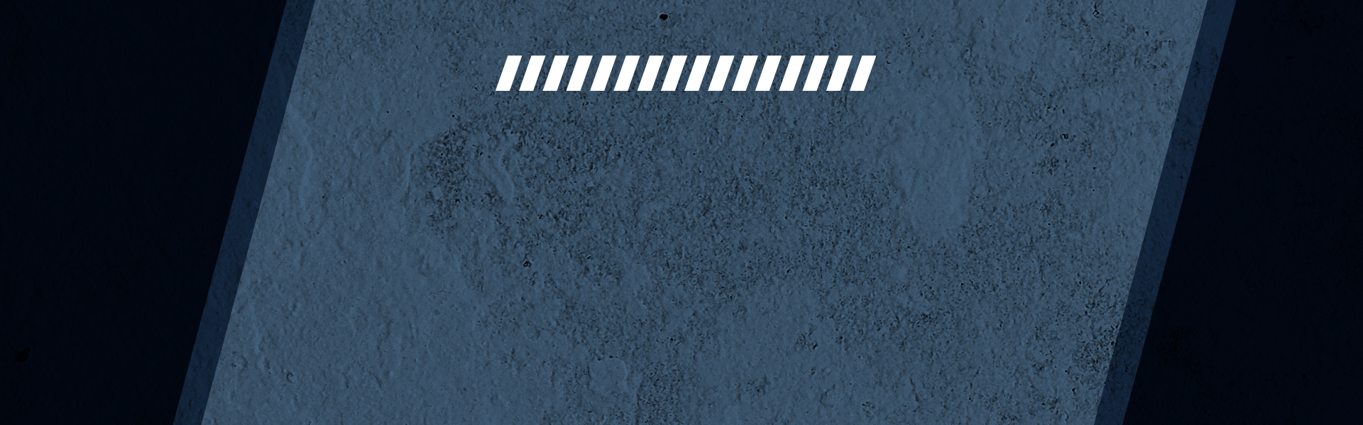 Blue concrete background with fancy triangles.