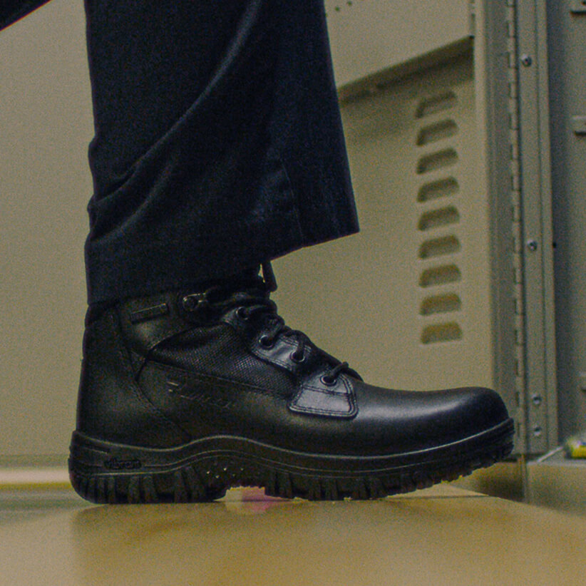 A Cyren boot steps onto the floor.