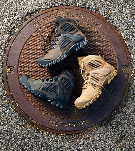 A collection of 3 Shock FX boots on a manhole cover