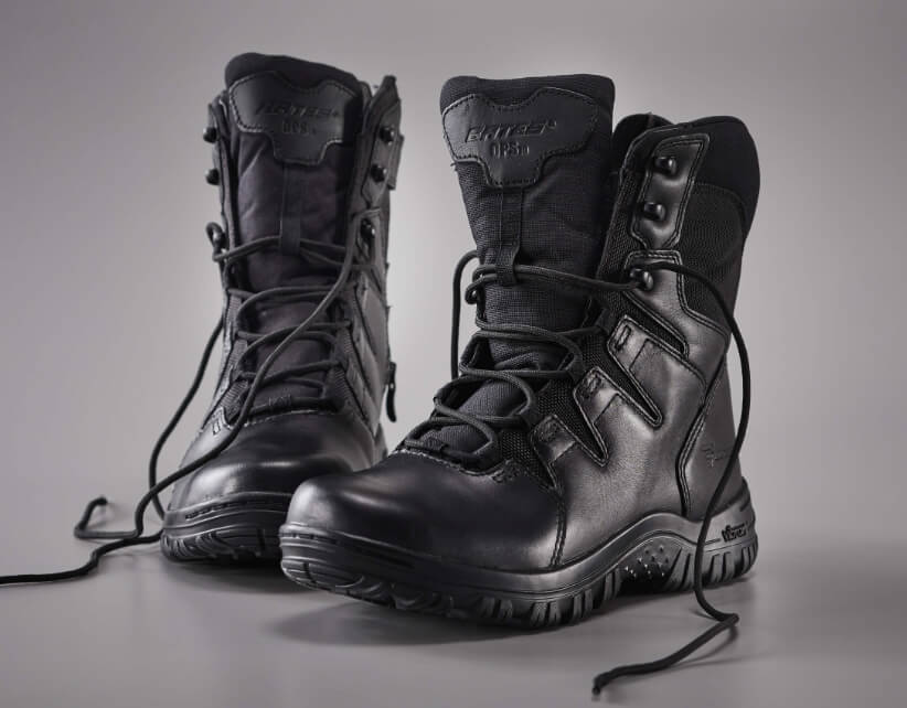 A pair of lovingly-worn boots sit empty.