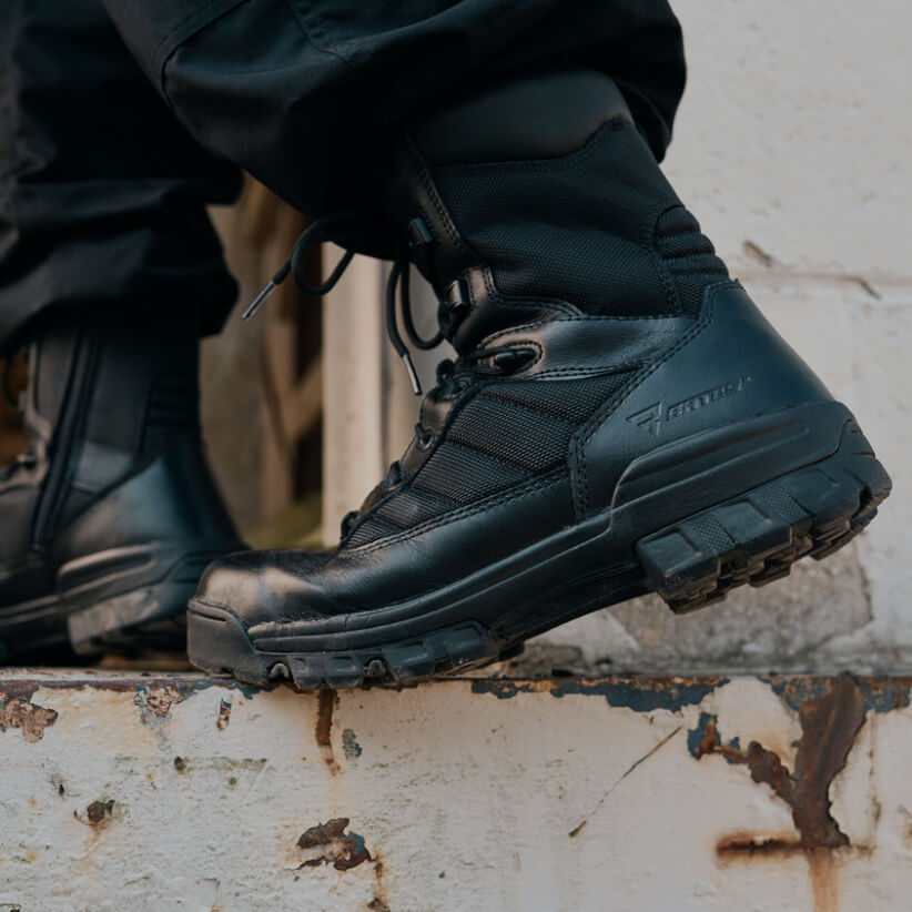 A pair of Ultralite boots entering a building.