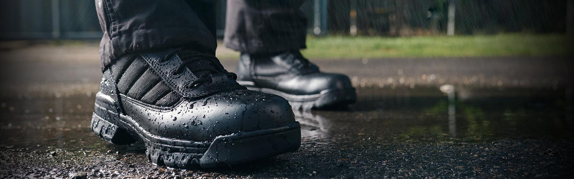 Ultralites standing on wet pavement.