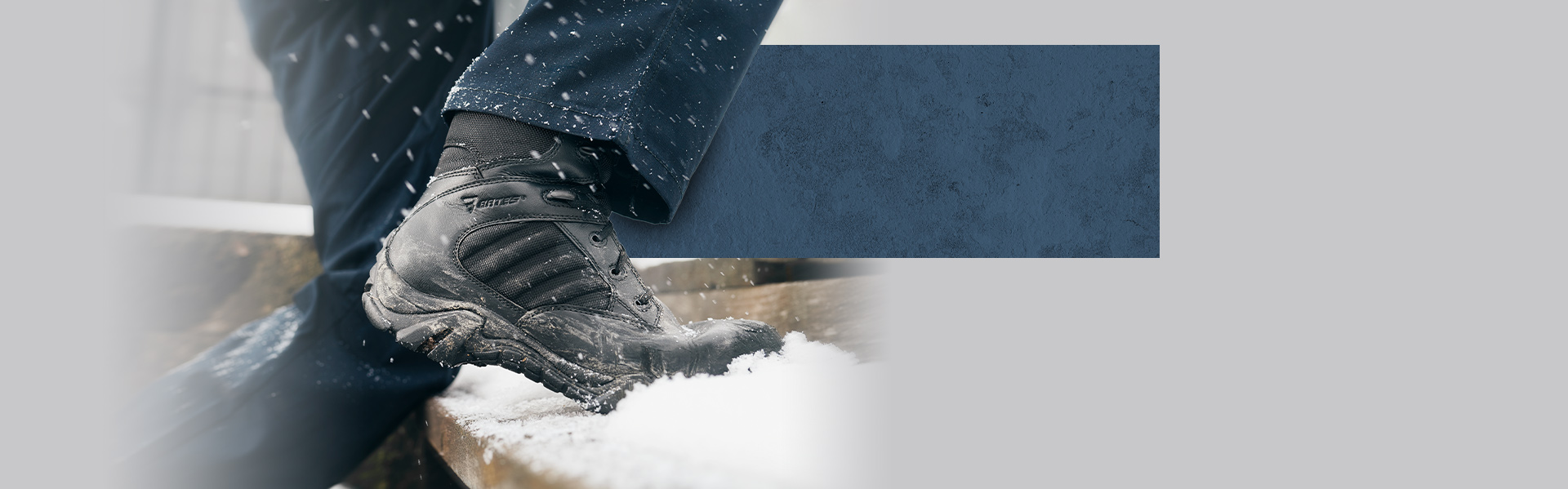 GX8 boots climbing snow-covered steps.